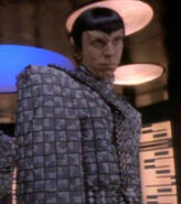 Romulan officer in transporter room, 2369